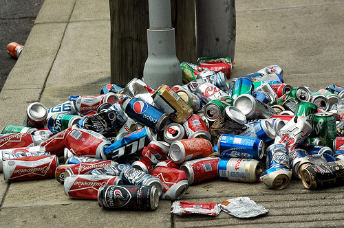 Pile of beer cans on the street.